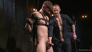 Gagged gay lad enjoys experienced male for a wicked BDSM