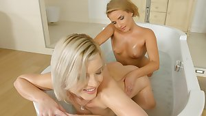 Energized blondes touch pussies in a gradual bathroom special